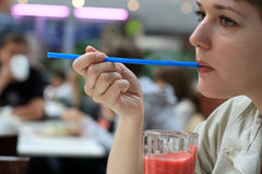 Girl with drinking straw Royalty Free Stock Photography