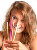 Girl with drinking straws Stock Photography