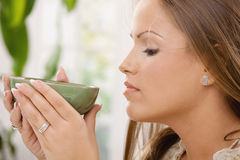 Girl drinking tea Stock Images