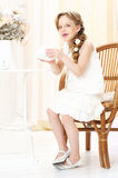 Girl drinking tea. Beautiful little girl with cup of tea Royalty Free Stock Photography