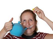 Girl drinking tea Stock Images