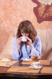 Girl drinking tea Royalty Free Stock Photos