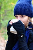 Girl drinking tea in the cold Stock Photo