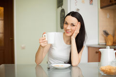 Girl drinking tea with cookie in the morning Royalty Free Stock Image