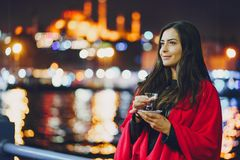 Girl drinking tea in Istanbul. Girl drinking hot tea by the bosphorus in Istanbul Turkey Stock Photos