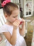 Girl drinking tea Royalty Free Stock Photography
