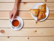 Girl drinking tea with uzbek national dish somsa Royalty Free Stock Photo