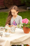 Girl drinking tea at yard at windy weather Stock Photos