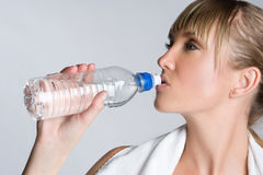 Girl Drinking Water. Pretty fitness girl drinking water Stock Photos