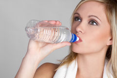 Girl Drinking Water. Pretty blond girl drinking water Stock Photography