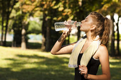 Girl drinking water Stock Photos