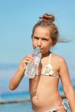 Girl drinking water Stock Photography