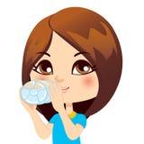 Girl Drinking Water. Cute little brunette girl drinking water from bottle Stock Photo