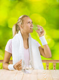 A girl drinking water Royalty Free Stock Photography