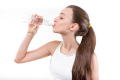 Girl drinking water Stock Images