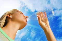 Girl drinking water Royalty Free Stock Image