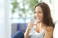 Free Girl Drinking Water At Home Stock Photo - 64827840