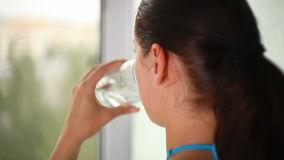 Girl drinking water stock footage