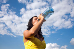 Girl drinking water from a bottle Stock Photography