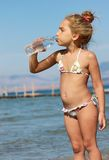 Girl drinking water from the bottle Royalty Free Stock Photos