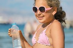 Girl drinking water from the bottle Royalty Free Stock Images