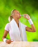 A girl drinking water from bottle Royalty Free Stock Photos