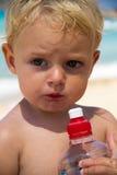 Girl drinking water Royalty Free Stock Photos