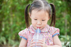 Girl drinking water from bottle Royalty Free Stock Photo