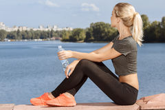 Girl drinking water on the breather Royalty Free Stock Image