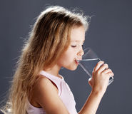 Girl drinking water from glass stock photo