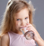 Girl drinking water from glass Royalty Free Stock Image