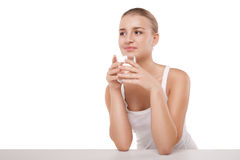 Girl drinking water from glass isolated. Close-up of pretty girl drinking water from glass isolated on white royalty free stock photos