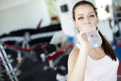 Girl drinking water in the gym Royalty Free Stock Image