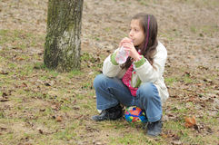 Girl Drinking Water In Park Royalty Free Stock Photography