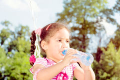 Girl drinking the water Stock Image