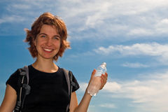 Girl drinking water outdoors Stock Photos