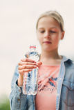 Girl drinking water outdoors Royalty Free Stock Photography