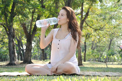 Girl is  Drinking water Royalty Free Stock Photography