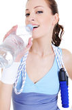 Girl drinking water after train Royalty Free Stock Photos
