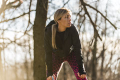 Girl drinking water during training in the nature. Girl working out in nature Royalty Free Stock Image