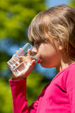 Girl drinking water Stock Image