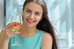 Girl drinking white wine and smiling. Stock Image
