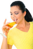 Girl Drinking Wine. Happy young woman drinking wine. isolated on white royalty free stock photos