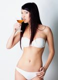 Girl drinking wine Stock Images