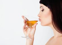 Girl drinking wine Royalty Free Stock Photos