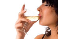 Girl drinking wine. Brunette girl is drinking wine with closed eyes on the white background Royalty Free Stock Photos