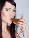 Girl drinking wine from goblet Royalty Free Stock Photography