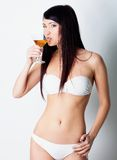 Girl drinking wine on white background Royalty Free Stock Photo