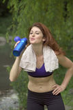 Girl drinking after workout. Give has a drink after work out in Central Park New York.  She was 26 at the time of shoot and Jewish American. Photographed June Royalty Free Stock Photos