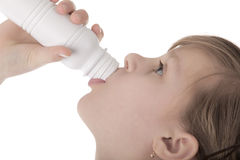 Girl drinking yoghurt Royalty Free Stock Image